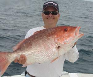 Man holding up a large Red Snapper with both hands