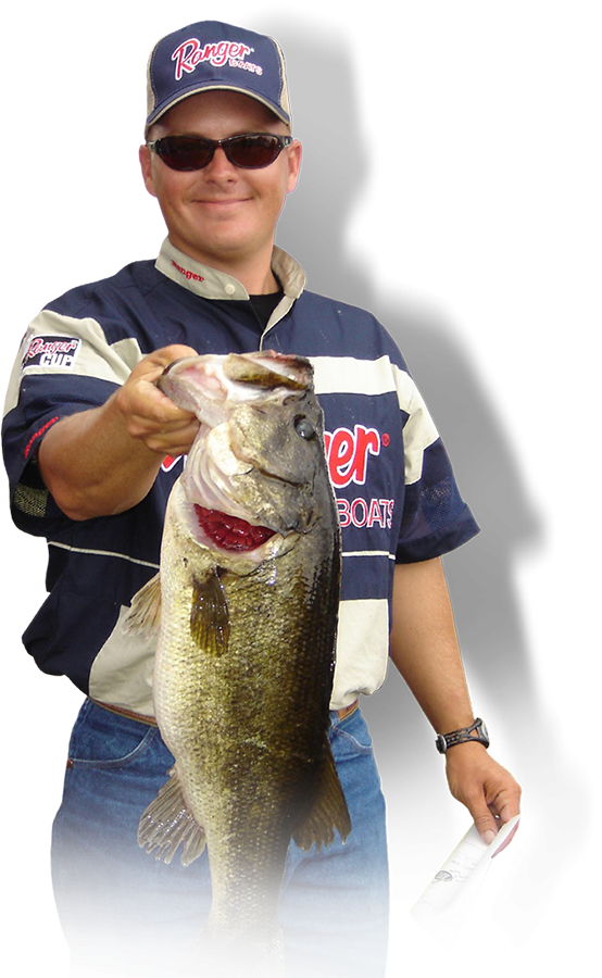 Captain holding up a Largemouth Bass
